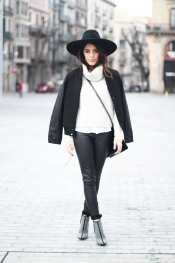 Winter street style look: white sweater, black pants