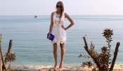The summer look: White lace dress with cream fur shawl and python clutch
