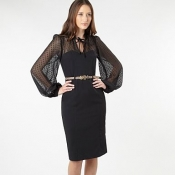 Black spotted long sleeved cocktail dress