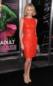 Charlize Theron in red dress at Young Adult Premiere