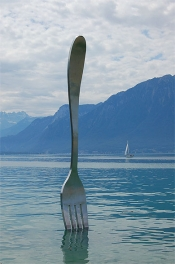 A big fork planted in the middle of a lake