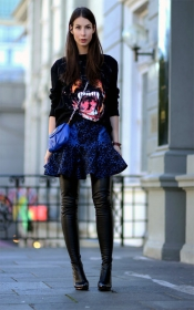 Givenchy sweater and Stella McCartney boots