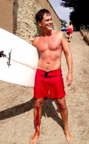 Rob Lowe shirtless, injured while surfing