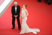 Emma Stone on a white dress on the Red Carpet